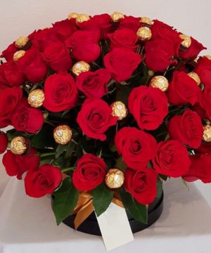 Roses and chocolates in basket, flower delivery in muscat